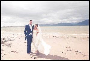 Bride and Groom on beach, wedding day