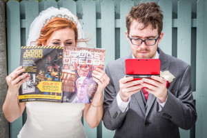 Bride and Groom with comic and gameboy
