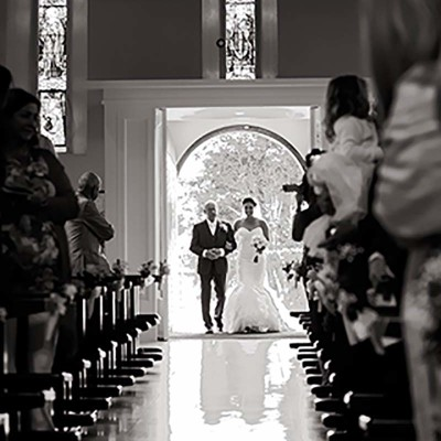 Bride with her father walking up the aisle