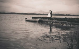 Bride and Groom standing on the pier at Killarney lakes