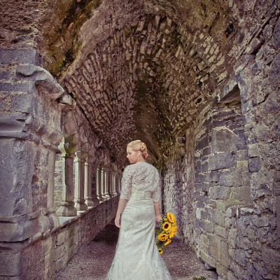 Back of brides dress under archway