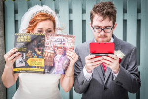Bride reading a comic, groom playing game boy