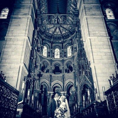 Interior of cork cathedral with bride and groom