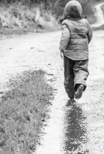 Boy running in the rain