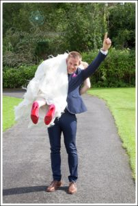 Groom carrying bride.