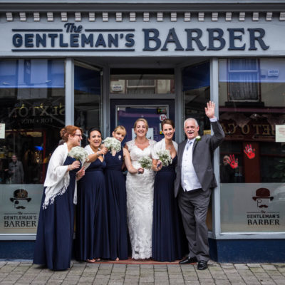 Bridesmaids and Dad outside Barbers